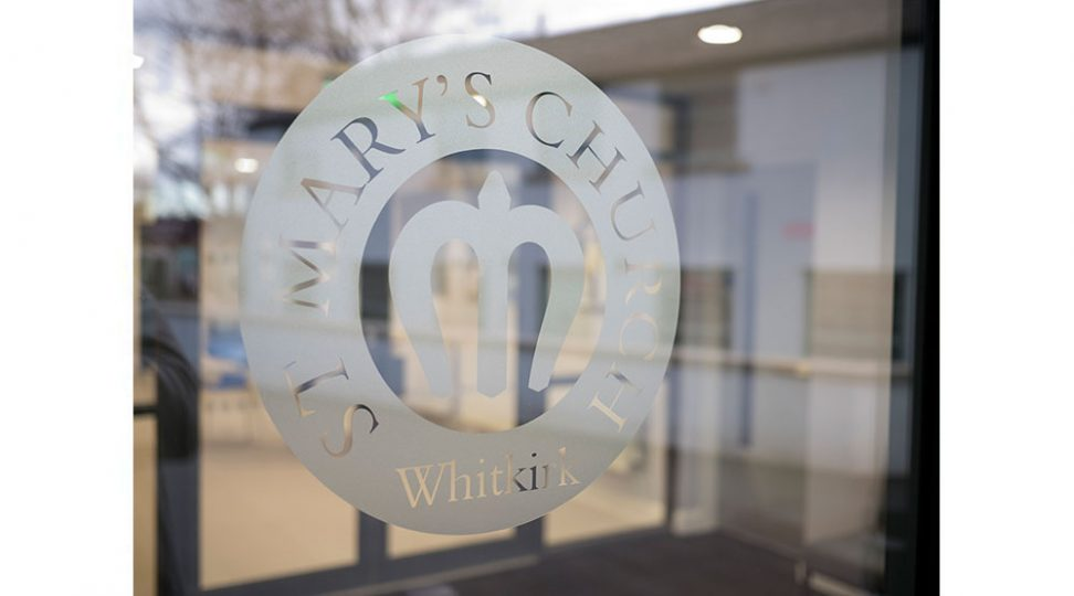 etched glass signage for a church logo