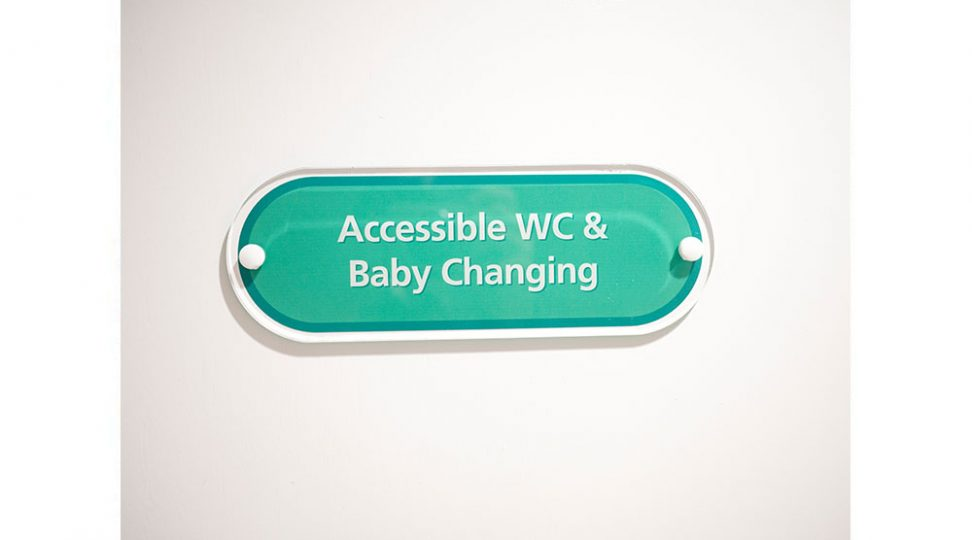 accessible WC an baby changing signage